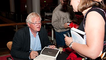 The author signing copies of The Book of the Moon